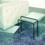 Conjunto de mesas nido cristal transparente.